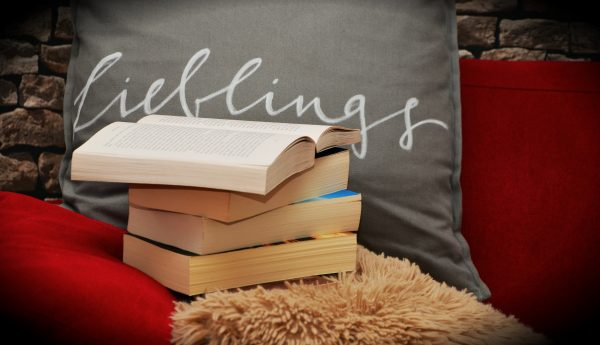 Stack of books on cozy chair